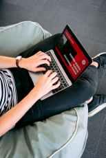 man creating a presentation on laptop